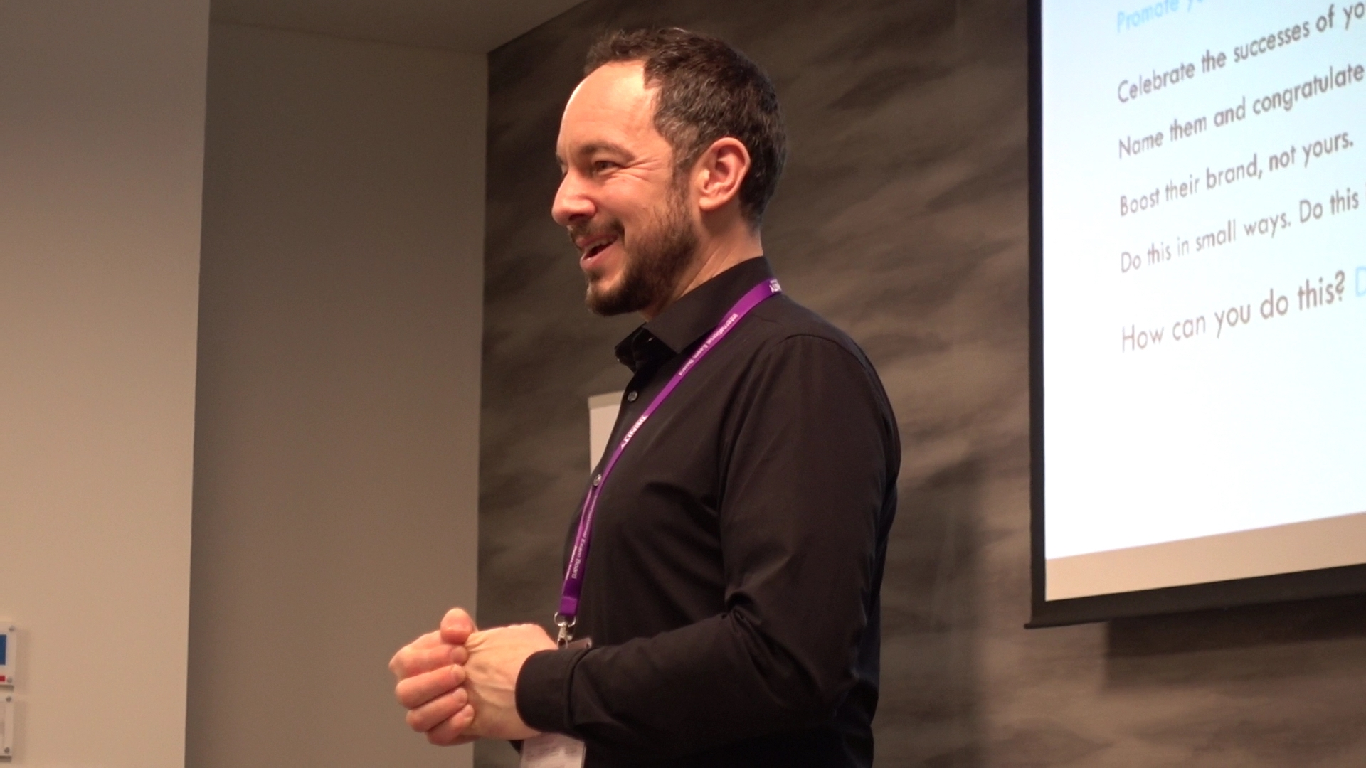 Richard Bradford of Disquiet Dog Marketing consultancy smiling as he looks at the audience out of view.
