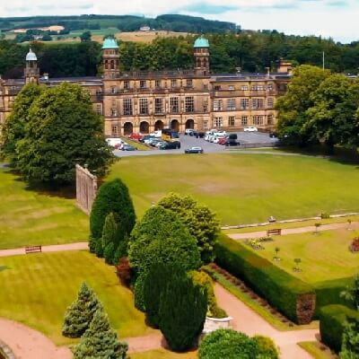 An aerial view of Stonyhurst College with its extensive lawn and gardens in front.